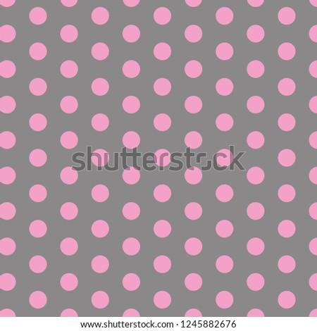 Polka dot pattern. Pink circles on grey background.