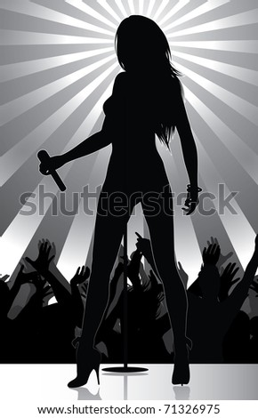 pop singer performing on stage with crowd cheering (available jpg version)