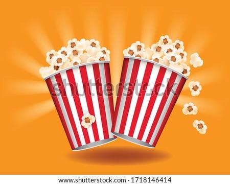 popcorn boxes on orange background