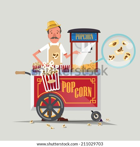 popcorn cart with seller  ...