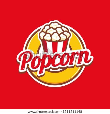 Popcorn logo badge with illustration of popcorn in bucket