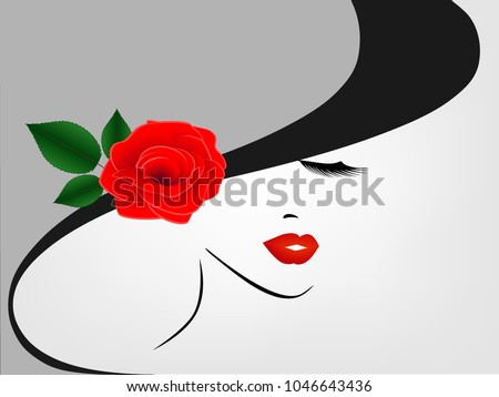 Portrait of a girl in a hat with a red rose on a gray background.