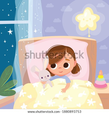 Portrait of baby girl lying in the bed under cover holding imaginary friend,bunny rabbit toy, in bedroom. Bed time for kids. Get ready for bedtime. Kid prepare go to bed