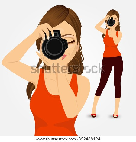 portrait of beautiful young photographer woman taking photos using her digital reflex camera