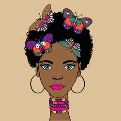 Portrait of the beautiful African woman in ancient jewelry and Afro-hair. African woman with colorful butterflies.
