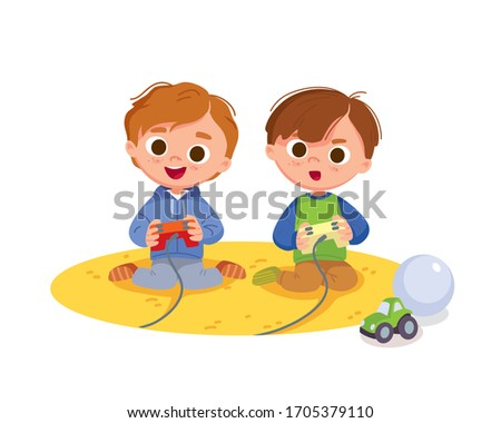 Portrait of two boys excitedly playing video games on game console. Boy play video games. Kids activity at home.