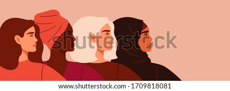 Portraits of Four women of different nationalities and cultures standing together. The concept of gender equality and of the female empowerment movement.