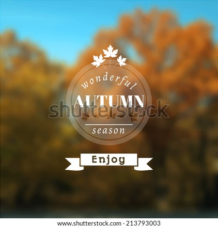 Poster with autumn landscape. Motto, slogan for autumn season. Maple leaves on a autumn forest background. Emblem for autumn poster. Circle emblem of wonderful autumn season on a photo background.