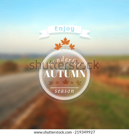 Poster with autumn landscape. Motto, slogan for autumn season. Maple leaves on a autumn road background. Emblem for autumn poster. Circle emblem of wonderful autumn season on a photo background.