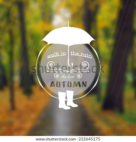 Poster with autumn landscape. Motto, slogan for autumn season. Umbrella and rubber boots on a autumn park background. Walk under the autumn rain. Circle emblem of  autumn season on a photo background.
