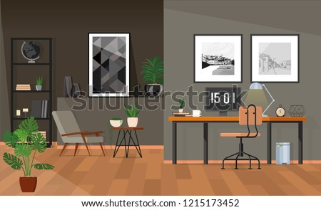 Posters above the desk with a monitor in a gray home office with plants.