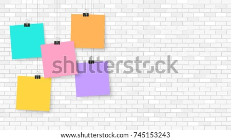 Posters on binder clips. Paper templates on brick wall. Realistic mock up. Empty notepad sheet for your business design. Brick wall. Vector templates for lettering, quote, images or logos.