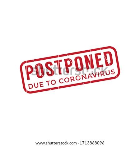 Postponed due to coronavirus stamp Stockfoto ©