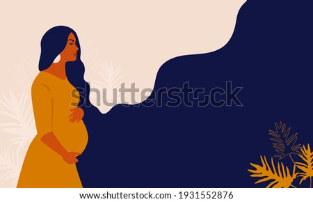 Pregnant woman on a background of leaves.The concept of pregnancy, motherhood, family. Happy mum. Pregnant belly side view. Pregnancy concept. Pregnant woman holds her belly. African american Pregnant