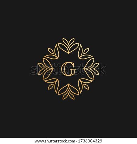 Premium linear ornamental letter G logo or monogram. Feminine floral decorative logo with leaf frame. Luxury alphabet symbol for cosmetics, organic, jewelry, beauty brand. Photo stock ©