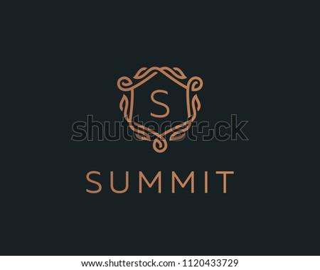 Premium linear shield monogram letter S logotype. Elegant crest leaf stamp icon vector logo. Luxury alphabet frame symbol.