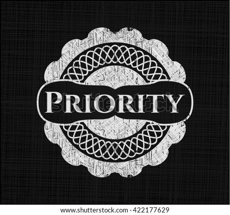 Priority chalkboard emblem on black board