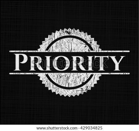 Priority chalkboard emblem written on a blackboard