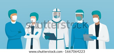 Professional doctors and nurses wearing protective suite and standing together to fight coronavirus