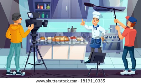Professional master chef in uniform cooking pizza at restaurant kitchen. Cameraman television crew recording culinary tv show program. Culinary course, training class, video blog live broadcasting