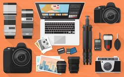 Professional photographer equipment on a desk, shooting and photo editing concept, flat lay