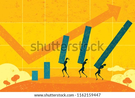 Profit Projections. Businesswomen projecting future profits using a life size bar graph.