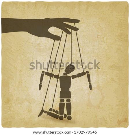 Puppet marionette on ropes is broken man on vintage background Stockfoto ©