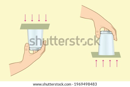 Putting paper in the mouth of the glass filled with water and not spilling the water when turned upside down Stok fotoğraf ©