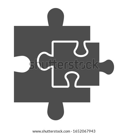 Puzzle additions solid icon. Two jigsaw pieces small and bigger. Social networking and communication vector design concept, glyph style pictogram on white background, use for web and app. Eps 10