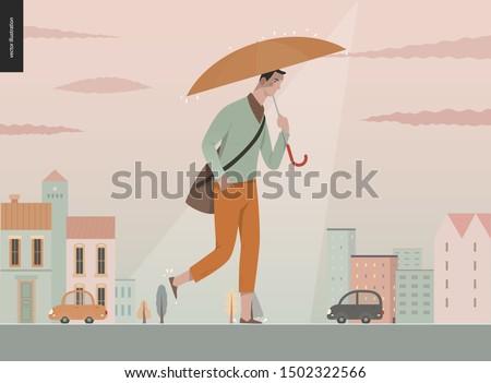 rain   walking young man