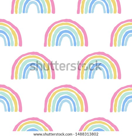 Rainbow cute seamless pattern on white background.Hand drawn pastel print with simple shapes in scandinavian style. Design for textile,fabric,wallpaper etc