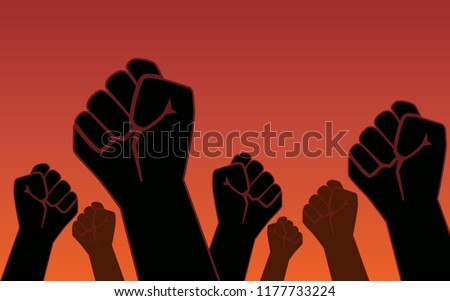 raised fist hand of protesters