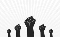 Raised Fist Hand Protest in flat icon design on black and white color ray background