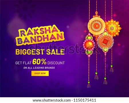 Raksha Bandhan Biggest Sale banner or poster design, get flat 60% discount offer with Hanging rakhi (wristbands) on purple mandala background. - Shutterstock ID 1150175411