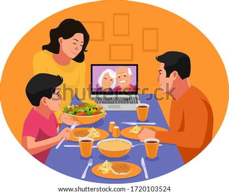 Ramadan in the time of corona. Happy family having dinner together. Video chat with family elders during dinner. Iftar eating after fasting. Stay home covid-19 concept.