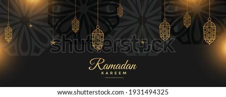 ramadan kareem holy festival banner in black and golden style