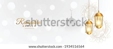 ramadan kareem white banner with golden islamic lantern