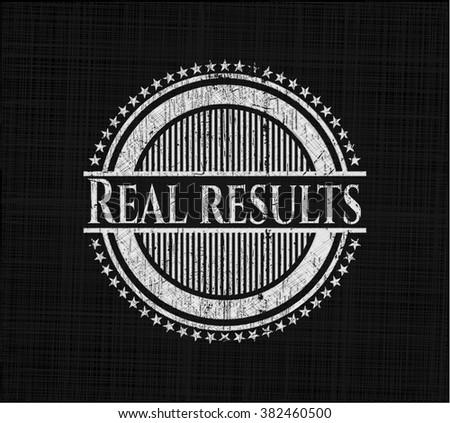 Real results chalk emblem written on a blackboard