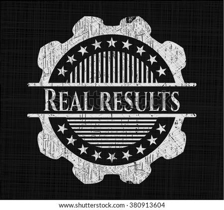 Real results written on a chalkboard