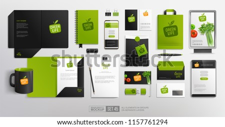 Realistic Brand identity Mockup set with Vegetal Logo for restaurant and natural food shop. Green and black color design stationery mock-up template with vector vegetables  and eco friendly packaging