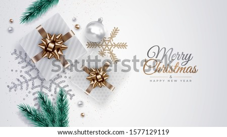 Realistic Christmas background with pine branches, gifts, ribbons,  ornaments, snowflakes, Xmas balls. Top view. Vector holiday illustration for banner, website, greeting card.