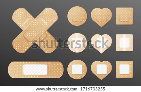 Realistic cross of medical plaster. Set of two sided adhesive plasters. Oblong, square, heart, round skin patch. Sticky bandage. Protective cover. Vector illustration  Сток-фото ©