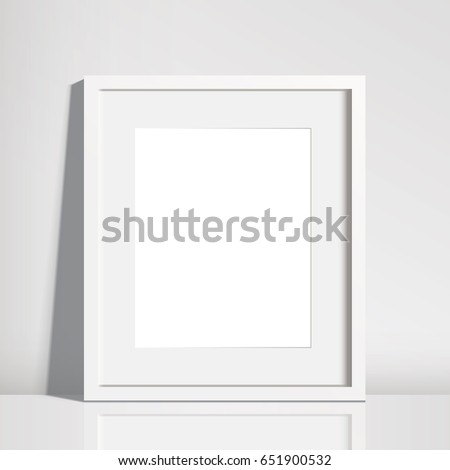 Realistic Empty White Picture Frame Mockup - 8x10 inch picture frame in portrait format. It is Isolated on a neutral off-white background with a subtle reflection. EPS10 file with transparency.