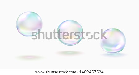 Realistic soap bubble with rainbow colors isolated on white background. Vector water foam bubbles set. Colorful iridescent glass ball or sphere template.