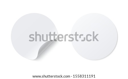 Realistic template of white round paper   adhesive sticker with curved edge isolated on white background.