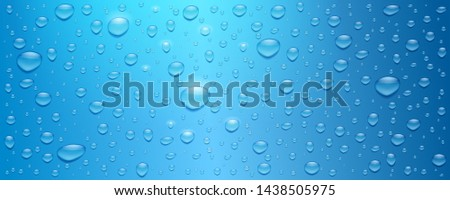 realistic water drops on blue