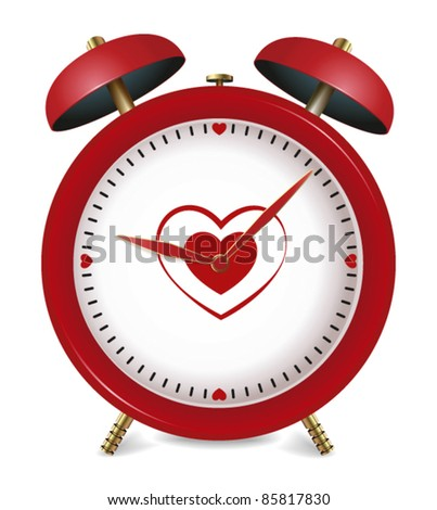 red alarm clock with hearts