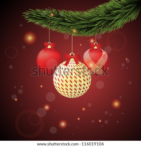 Red and gold Christmas ornaments with Christmas tree branch on a dark red background.