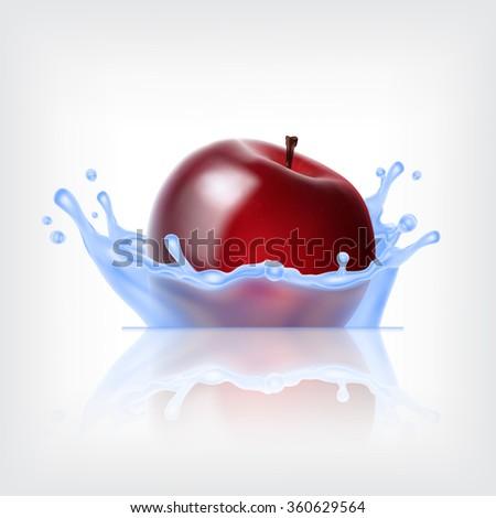 red apple in water splash