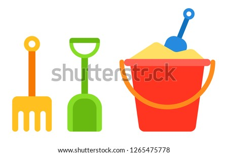 red baby bucket with sand and